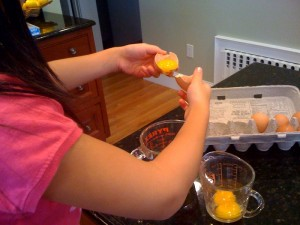 Lilah separating eggs